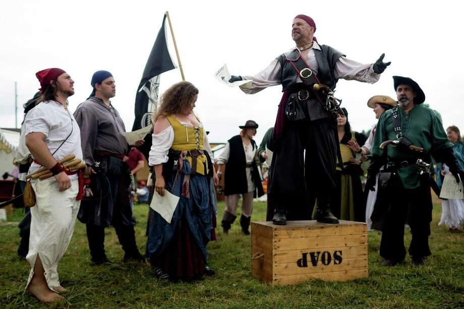 A gaggle of pirates rally to invade a beer garden over injustices done to them at The Washington Midsummer Renaissance Faire Saturday, August 3, 2013, at The Kelley Farm in Bonney Lake. The event continues August 10-11 and 17-18. Photo: JORDAN STEAD, SEATTLEPI.COM / SEATTLEPI.COM
