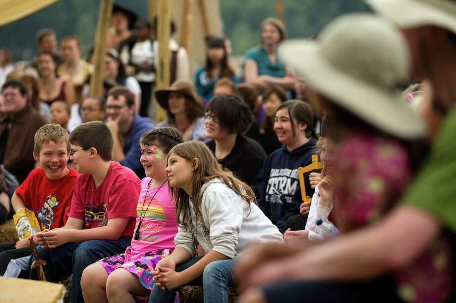 Familes watch a presentation on the Auld Lyon Theatre stage during The Washington Midsummer Renaissance Faire Saturday, August 3, 2013, at The Kelley Farm in Bonney Lake. The event continues August 10-11 and 17-18. Photo: JORDAN STEAD, SEATTLEPI.COM / SEATTLEPI.COM