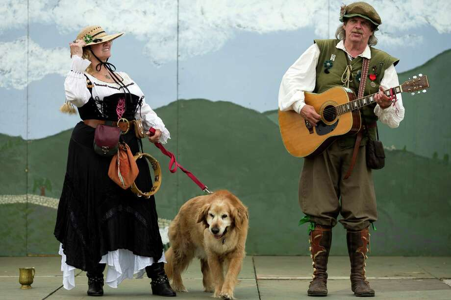 Performers sing for onlookers during The Washington Midsummer Renaissance Faire Saturday, August 3, 2013, at The Kelley Farm in Bonney Lake. The event continues August 10-11 and 17-18. Photo: JORDAN STEAD, SEATTLEPI.COM / SEATTLEPI.COM