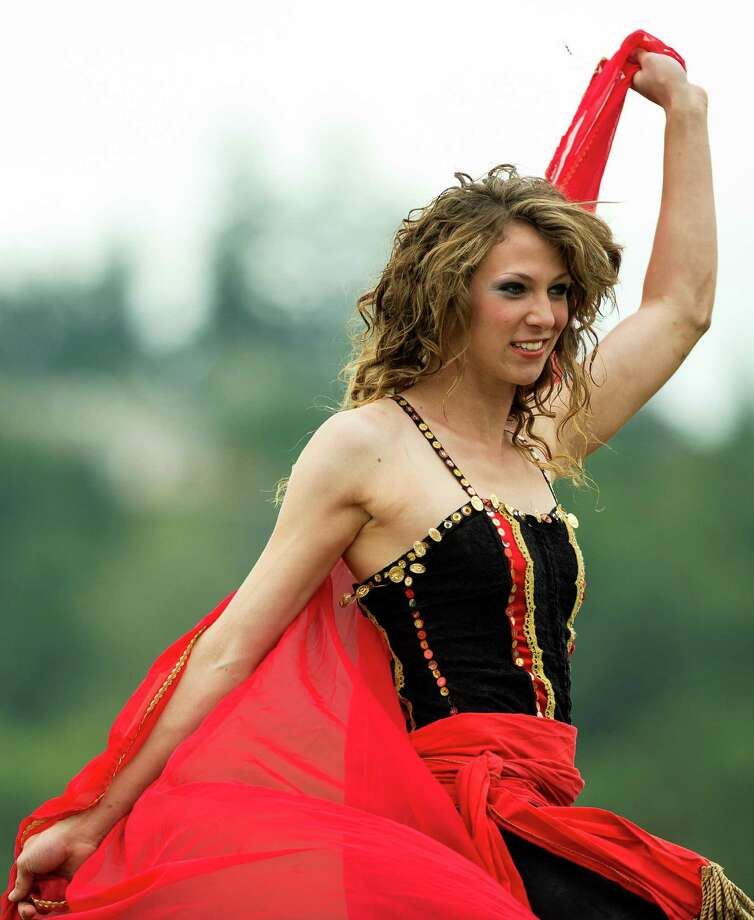 A dancer from the Ma'Ceo Gypsy Horse Extravaganza presented by Cavallo Equestrian Arts performs for onlookers at The Washington Midsummer Renaissance Faire Saturday, August 3, 2013, at The Kelley Farm in Bonney Lake. The event continues August 10-11 and 17-18. Photo: JORDAN STEAD, SEATTLEPI.COM / SEATTLEPI.COM