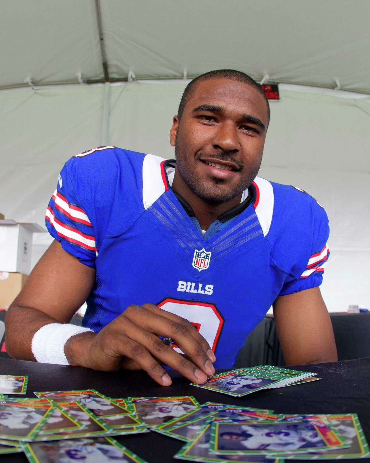 IMAGE DISTRIBUTED FOR NFLPA - Buffalo Bills' E.J. Manuel signs football cards at the NFLPA Rookie Premiere, on Saturday, May 18, 2013 in Pasadena, Calif. (Jeff Lewis / AP Images for NFLPA)