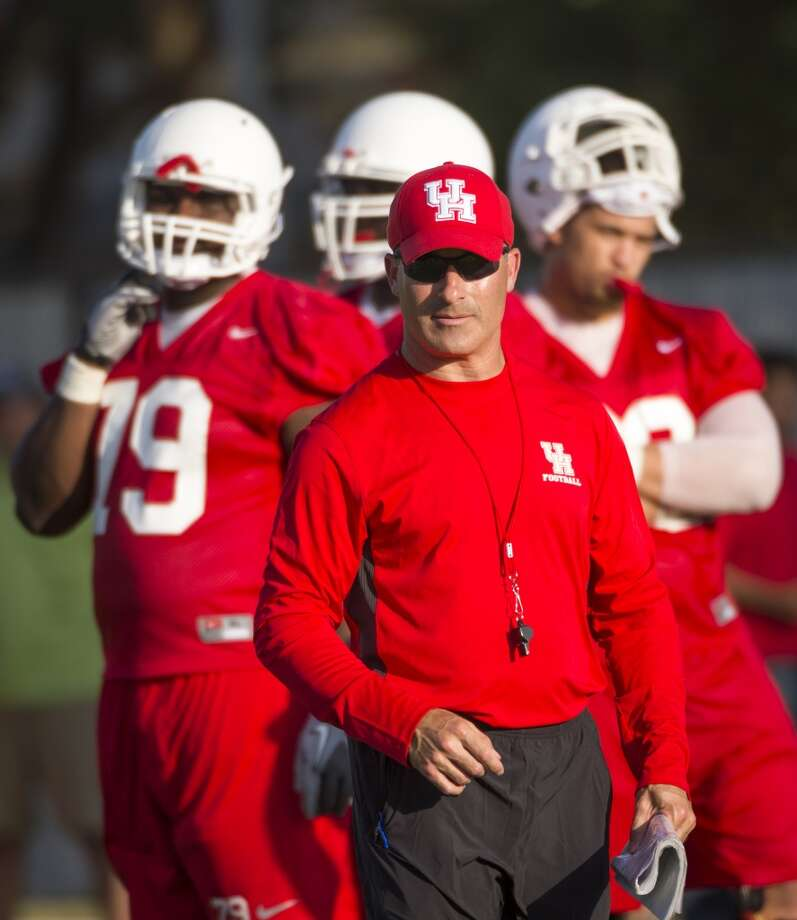 Houston Cougars head coach Tony Levine watches his team workout. Photo: Smiley N. Pool, Houston Chronicle