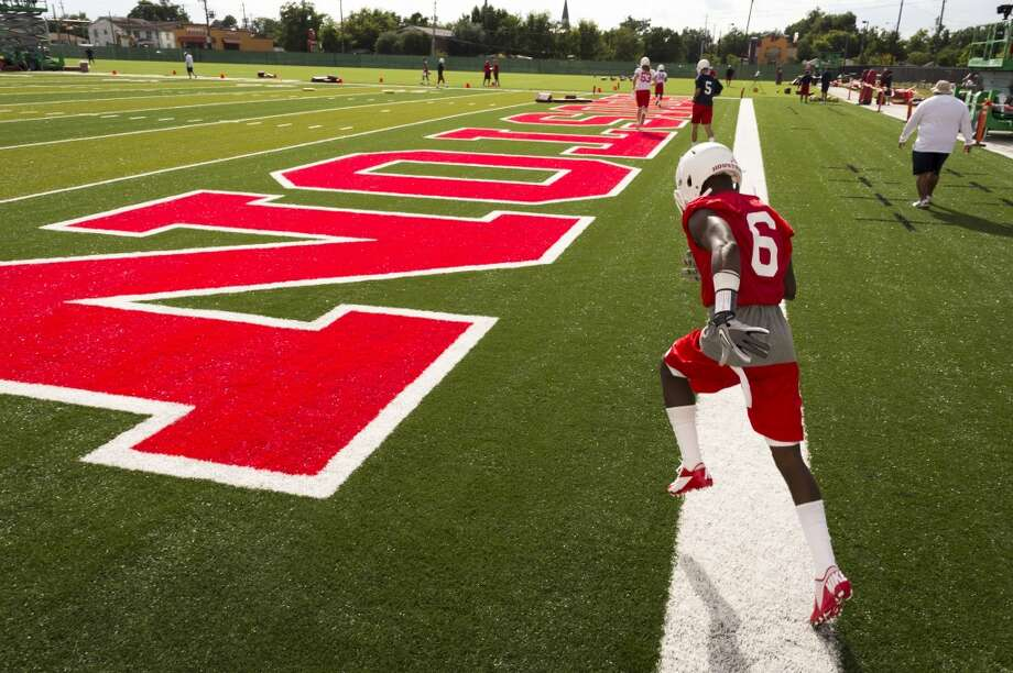Houston Cougars wide receiver Larry McDuffey runs onto the field for the first fall football practice. Photo: Smiley N. Pool, Houston Chronicle