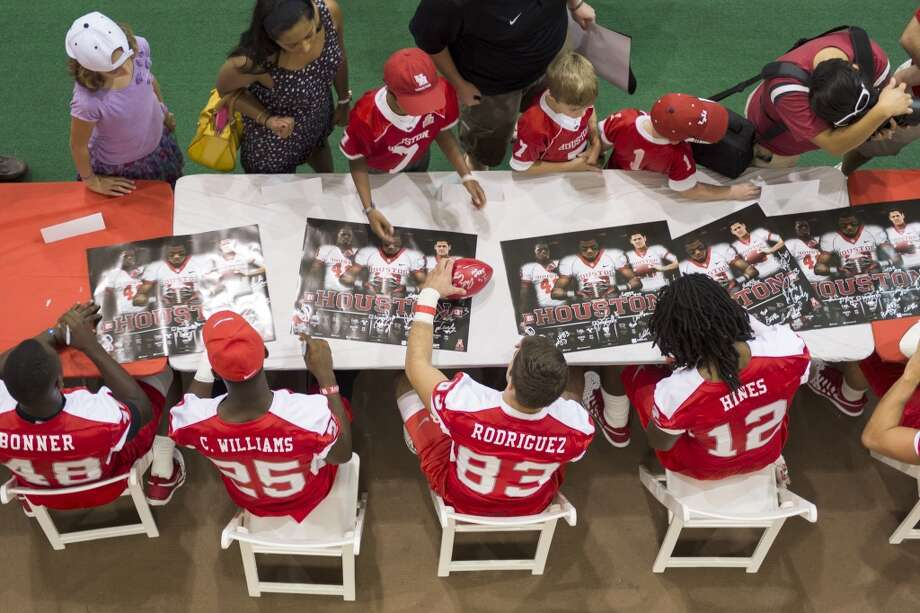 Houston Cougars players sign autographs during a fan fest. Photo: Smiley N. Pool, Houston Chronicle