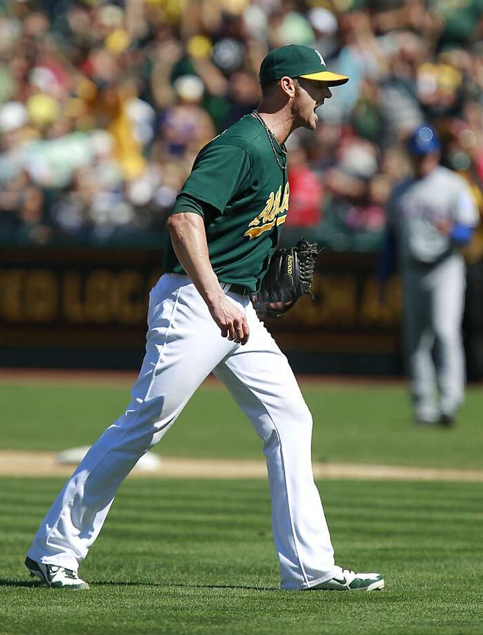 A's closer Grant Balfour (50), gets the last out in the ninth inning for his 29th save of the year as the Oakland Athletics beat the Texas Rangers 4-2 at O.co Coliseum in Oakland, Calif., on Saturday August 3, 2013,. Photo: Michael Macor, San Francisco Chronicle