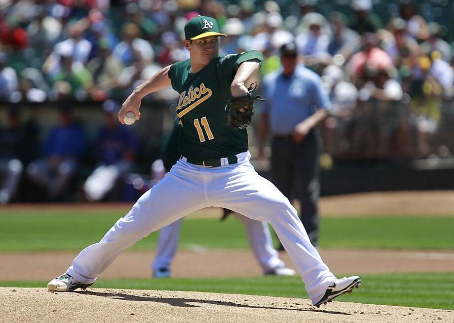 A's starting pitcher, Jarrod Parker, (11) throws in the first inning, as the Oakland Athletics take on the Texas Rangers at O.co Coliseum in Oakland, Calif.,  on Saturday August 3, 2013,. Photo: Michael Macor, San Francisco Chronicle