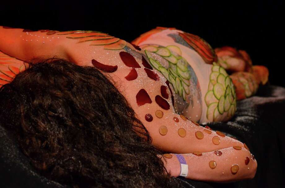 """Cucumbers, beets, grapes, and other vegetables cover human bodies as part of Tiberio Simone's art piece titled """"La Figa"""" during the 2013 Seattle Erotic Art Festival at the Showbox SODO Friday, Aug. 2, 2013, in Seattle. Warning: Some partial nudity shown in these photos. Photo: SY BEAN, SEATTLEPI.COM / SEATTLEPI.COM"""