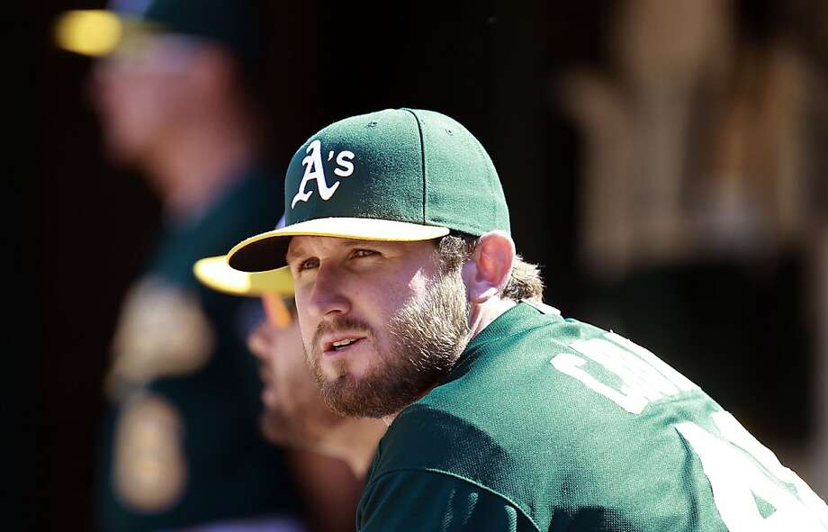 A's pitcher Ryan Cook, (48) watches from the dugout during the ninth inning, as the Oakland Athletics went on to beat the Texas Rangers 4-2 at O.co Coliseum in Oakland, Calif.,  on Saturday August 3, 2013,. Photo: Michael Macor, San Francisco Chronicle