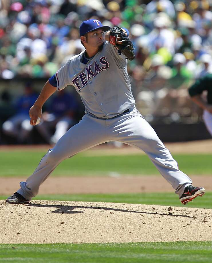 Rangers' starting pitcher Matt Garza, (22) throws in the first inning, as the Oakland Athletics take on the Texas Rangers at O.co Coliseum in Oakland, Calif.,  on Saturday August 3, 2013,. Photo: Michael Macor, San Francisco Chronicle