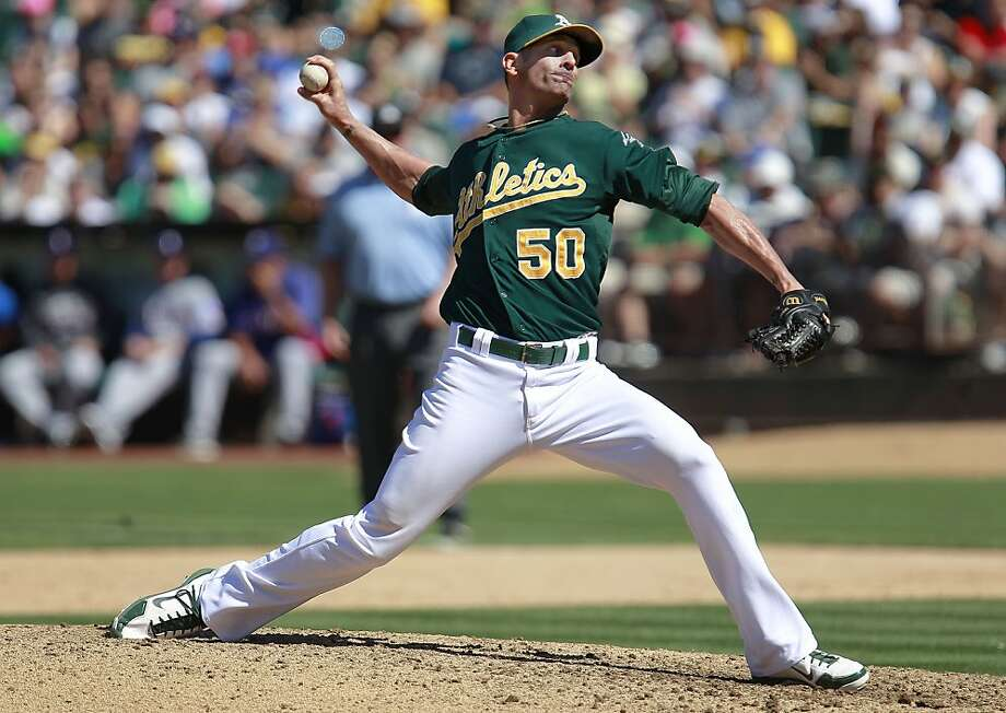 A's closer Grant Balfour, (50) in to pitch in the ninth inning, as the Oakland Athletics went on to beat the Texas Rangers 4-2 at O.co Coliseum in Oakland, Calif.,  on Saturday August 3, 2013,. Photo: Michael Macor, San Francisco Chronicle