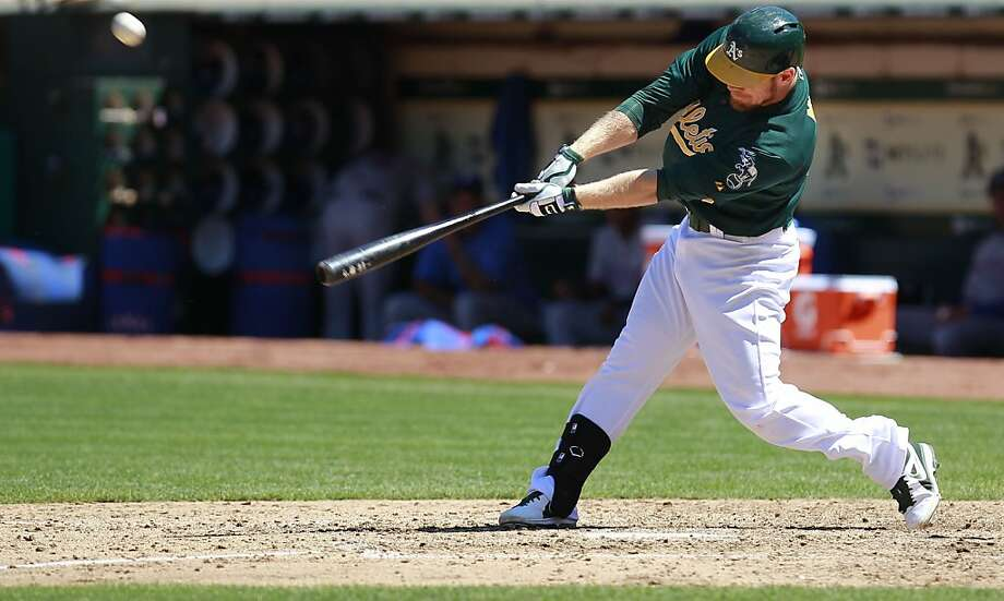 A's Brandon Moss, (37) hits a double to center in the sixth inning, as the Oakland Athletics went on to beat the Texas Rangers 4-2 at O.co Coliseum in Oakland, Calif.,  on Saturday August 3, 2013,. Photo: Michael Macor, San Francisco Chronicle