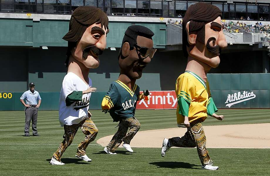 A new feature during the seventh inning stretch matches up hall of famers, Dennis Eckersley, Ricky Henderson and Rollie Fingers in a race around the field. The Oakland Athletics went on to beat the Texas Rangers 4-2 at O.co Coliseum in Oakland, Calif.,  on Saturday August 3, 2013,. Photo: Michael Macor, San Francisco Chronicle
