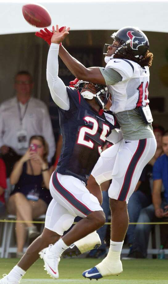 Cornerback Kareem Jackson, left, does his best to do what few have done in camp - keep up with DeAndre Hopkins. Photo: Brett Coomer, Staff / © 2013 Houston Chronicle
