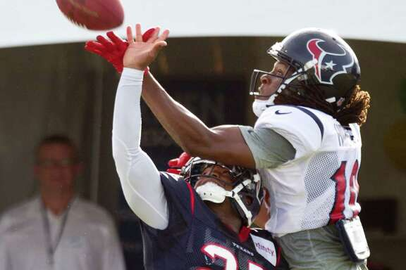 Cornerback Kareem Jackson, left, does his best to do what few have done in camp - keep up with DeAndre Hopkins.
