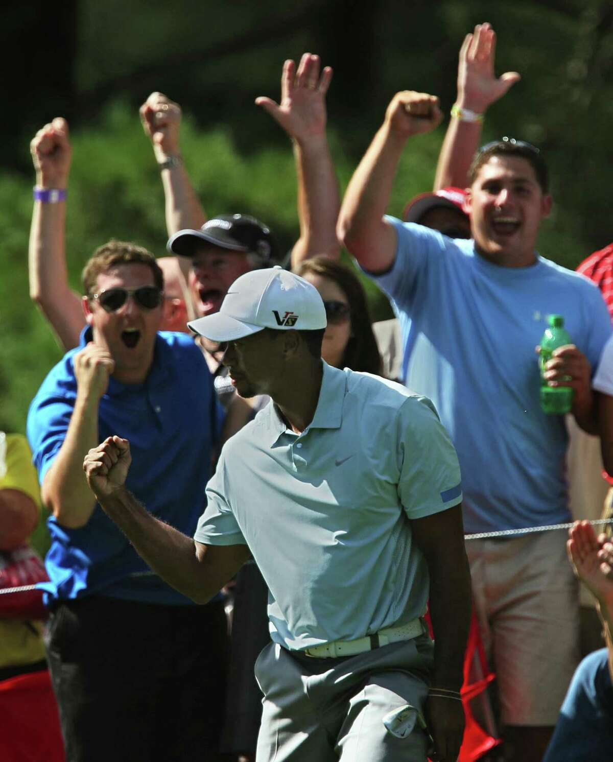 Tiger Woods wasn't on pace to tie his career-best round like he did Friday, but the Bridgestone leader did enough Saturday to maintain his seven-shot cushion.