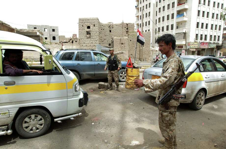 Yemeni police man a checkpoint in Saana soon after the U.S. State Department received intelligence about potential attacks by an al-Qaida affiliate in Yemen. Photo: Mohammed Huwais / Getty Images
