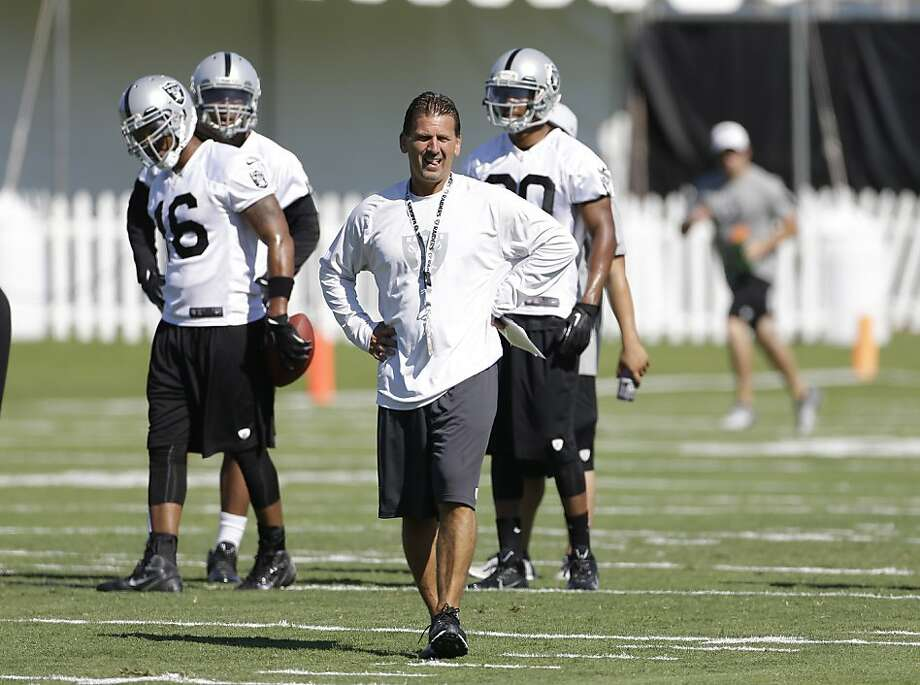 Offensive coordinator Greg Olson studies his players during drills at the Raiders' training camp in Napa. Photo: Eric Risberg, Associated Press