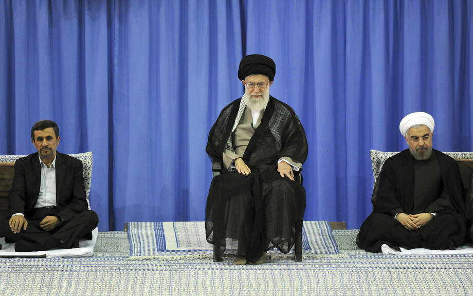 Supreme Leader Ayatollah Ali Khamenei (center), President-elect Hasan Rouhani (right) and outgoing President Mahmoud Ahmadinejad participate in Saturday's endorsement ceremony for Rouhani. Photo: Office Of The Iranian Supreme Leader / Associated Press
