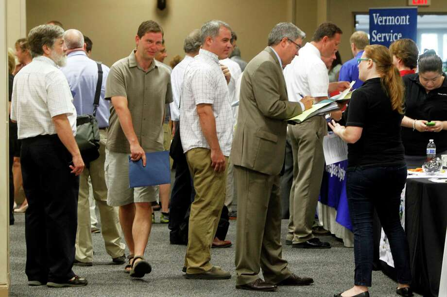 FILE - This July 15, 2013 photo, people line up at the job fair  in South Burlington, Vt.  The 162,000 jobs the economy added in July were a disappointment. The quality of the jobs was even worse. A disproportionate number of the added jobs were part-time or low-paying, or both. Part-time work accounted for more than 65 percent of the positions employers added in July. Low-paying retailers, restaurants and bars supplied more than half July's job gain. (AP Photo/Toby Talbot) ORG XMIT: NY114 Photo: Toby Talbot / AP