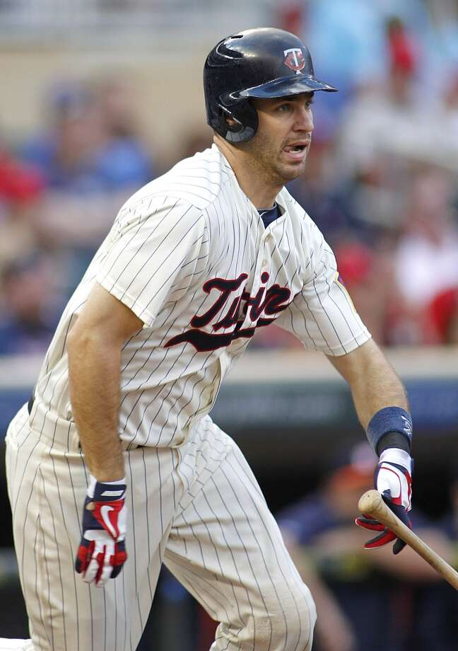Twins Joe Mauer runs after a hit that scored a run in the first inning. Photo: ANDY CLAYTON-KING, Associated Press