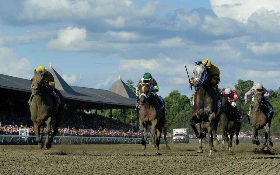 Cross Traffic with jockey John Velazquez, left  holds off a late charge from Successful Dan with jockey Julien Leparoux crosses the wire first in the 86th running of The Whitney Invitational Aug. 3, 2013, at the Saratoga Race Course in Saratoga Springs, N.Y.    (Skip Dickstein/Times Union) Photo: SKIP DICKSTEIN