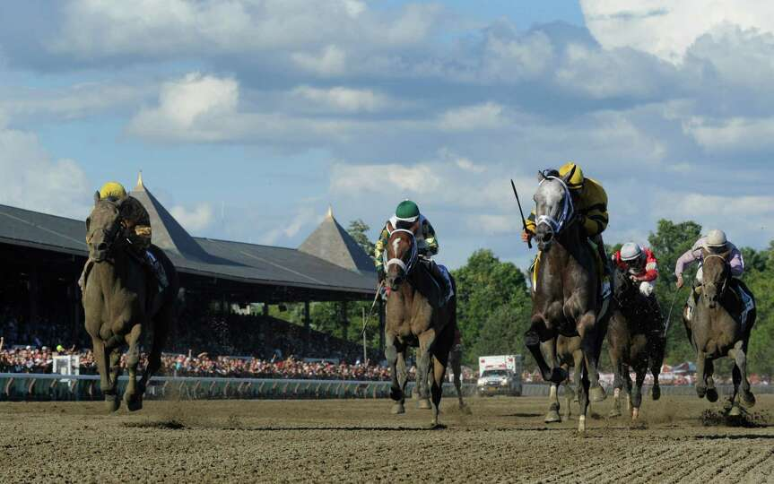 Cross Traffic with jockey John Velazquez, left  holds off a late charge from Successful Dan with joc