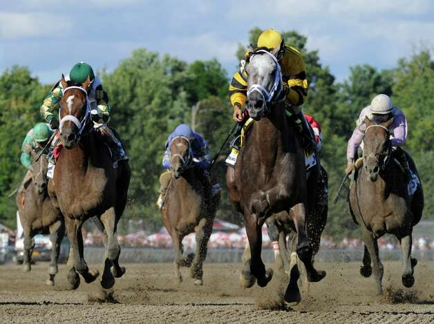 Cross Traffic with jockey John Velazquez crosses the wire first in the 86th running of The Whitney Invitational Aug. 3, 2013, at the Saratoga Race Course in Saratoga Springs, N.Y.    (Skip Dickstein/Times Union) Photo: SKIP DICKSTEIN