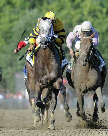 Cross Traffic with jockey John Velazquez crosses the wire first in the 86th running of The Whitney I
