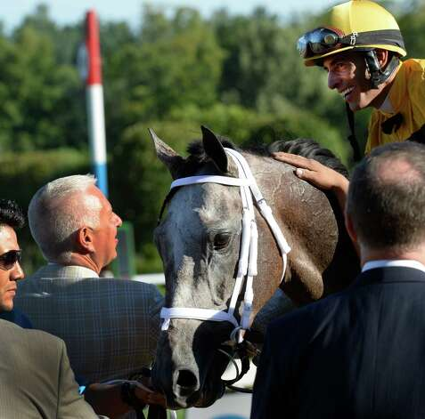 Jockey John Velazquez, right is congratulated by trainer Todd Pletcher, left after the victory in the 86th running of The Whitney Invitational Aug. 3, 2013, at the Saratoga Race Course in Saratoga Springs, N.Y.    (Skip Dickstein/Times Union) Photo: SKIP DICKSTEIN