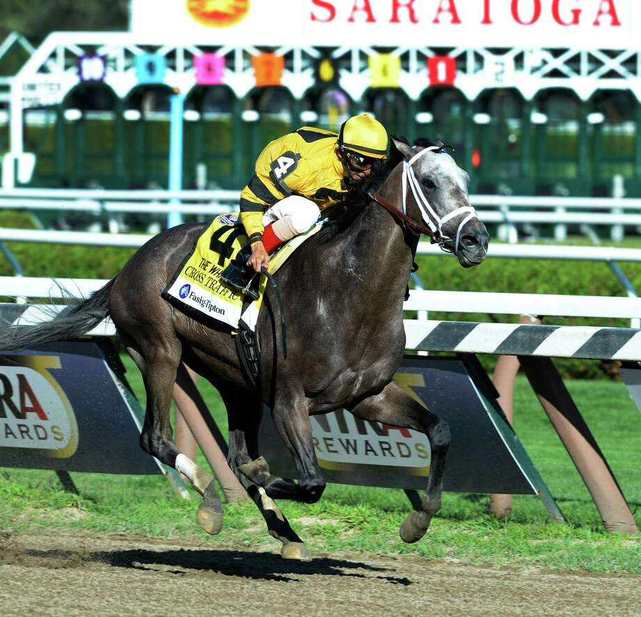 Cross Traffic with jockey John Velazquez cruises to the wire first in the 86th running of The Whitney Invitational Aug. 3, 2013, at the Saratoga Race Course in Saratoga Springs, N.Y.    (Skip Dickstein/Times Union) Photo: SKIP DICKSTEIN