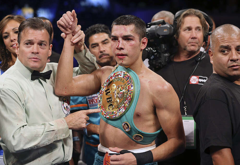 "Weslaco's Omar Figueroa Jr. outlasted Japan's Nihito Arakawa in a 12-round slugfest to win the interim WBC lightweight title in what is widely being hailed as the fight of the year as part of ""Knockout Kings II."" Photo: Tom Reel / San Antonio Express-News"
