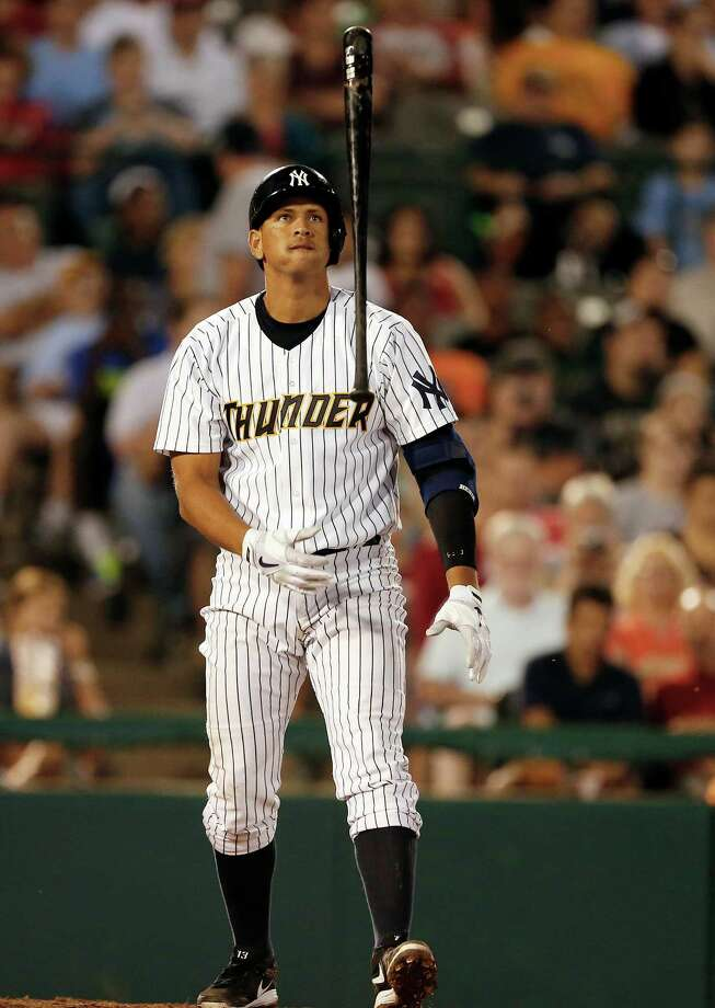 New York Yankees' Alex Rodriguez flips his bat after missing a pitch in the fifth inning of a Class AA baseball game with the Trenton Thunder against the Reading Phillies Saturday, Aug. 3, 2013, in Trenton, N.J. (AP Photo/Rich Schultz) ORG XMIT: NJRS111 Photo: RICH SCHULTZ / FR27227 AP