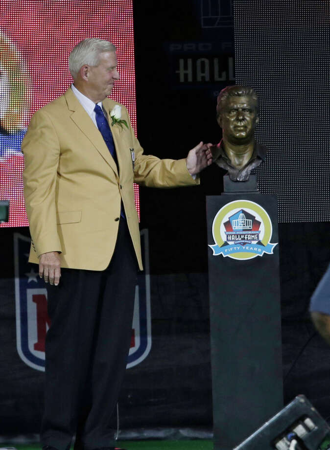 Former NFL football head coach Bill Parcells looks at his bust after the unveiling during the induction ceremony at the Pro Football Hall of Fame Saturday, Aug. 3, 2013, in Canton, Ohio. (AP Photo/Tony Dejak) ORG XMIT: OHTD115 Photo: Tony Dejak / AP