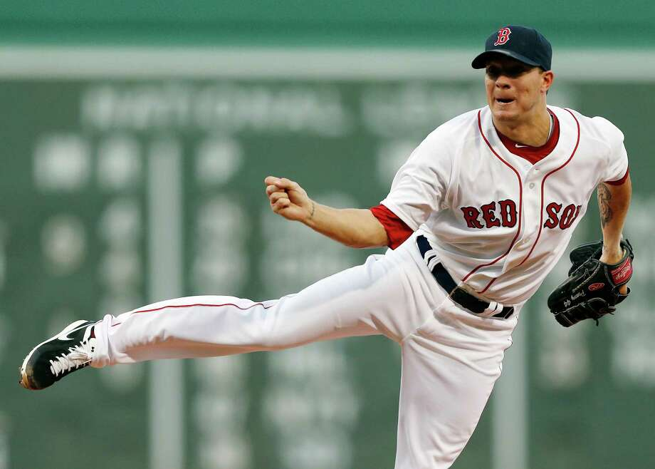 Boston Red Sox's Jake Peavy pitches in the second inning of a baseball game against the Arizona Diamondbacks in Boston, Saturday, Aug. 3, 2013. (AP Photo/Michael Dwyer) ORG XMIT: MAMD103 Photo: Michael Dwyer / AP