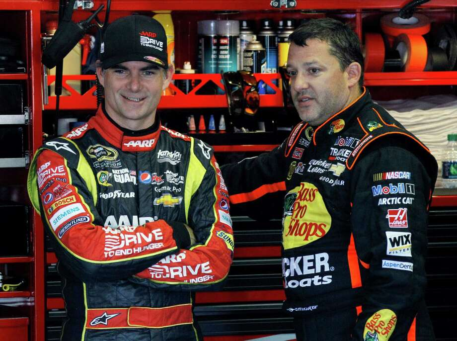 Drivers Jeff Gordon, left, and Tony Stewart talk in the garage during practice for Sunday's NASCAR Sprint Cup Series auto race, Friday Aug. 2, 2013, in Long Pond, Pa. (AP Photo/Russ Hamilton Sr.) ORG XMIT: PAME109 Photo: Russ Hamilton Sr. / FR47333 AP