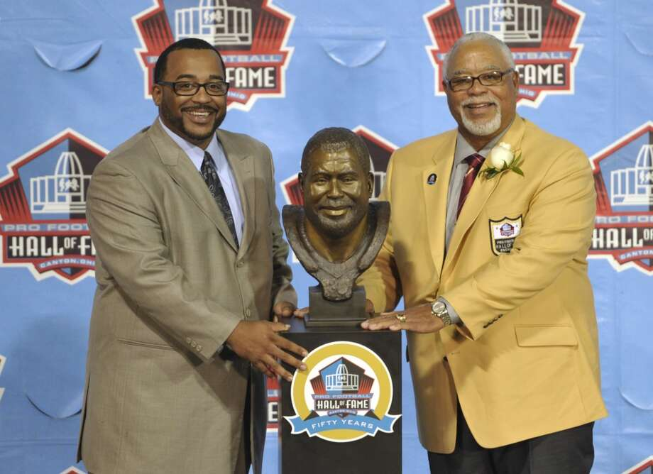 Inductee Curley Culp, right, poses with his presenter, his son Chad Culp, and a bust of himself during the induction ceremony at the Pro Football Hall of Fame Saturday, Aug. 3, 2013, in Canton, Ohio. (AP Photo/David Richard) Photo: David Richard, Associated Press