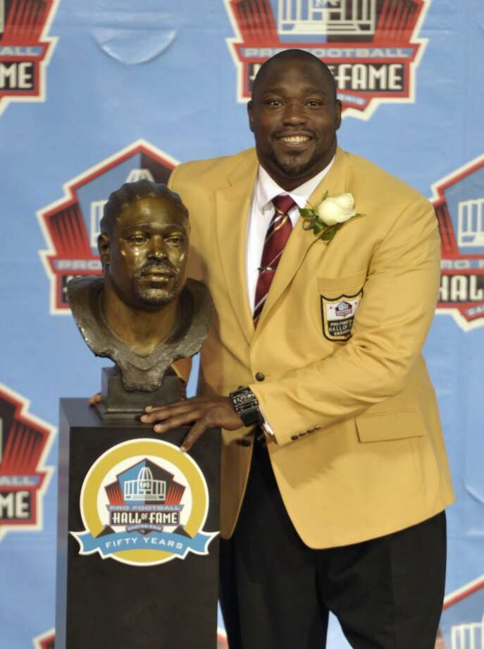 Hall of Fame inductee Warren Sapp poses with his bust during the 2013 Pro Football Hall of Fame Induction Ceremony Saturday, Aug. 3, 2013, in Canton, Ohio. (AP Photo/David Richard) Photo: David Richard, Associated Press