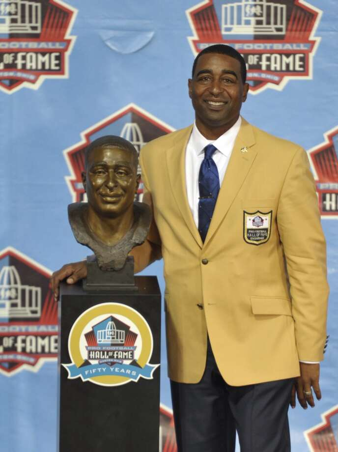 Hall of Fame inductee Cris Carter poses with his bust during the 2013 Pro Football Hall of Fame Induction Ceremony Saturday, Aug. 3, 2013, in Canton, Ohio. (AP Photo/David Richard) Photo: David Richard, Associated Press