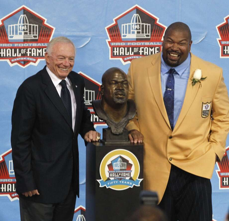 Jerry Jones and Larry Allen pose with Allen's bust during the Pro Football Hall of Fame 2013 Enshrinement Ceremony at Fawcett Stadium in Canton, Ohio, on Saturday, August 3, 2013. (Rodger Mallison/Fort Worth Star-Telegram/MCT) Photo: Rodger Mallison, McClatchy-Tribune News Service