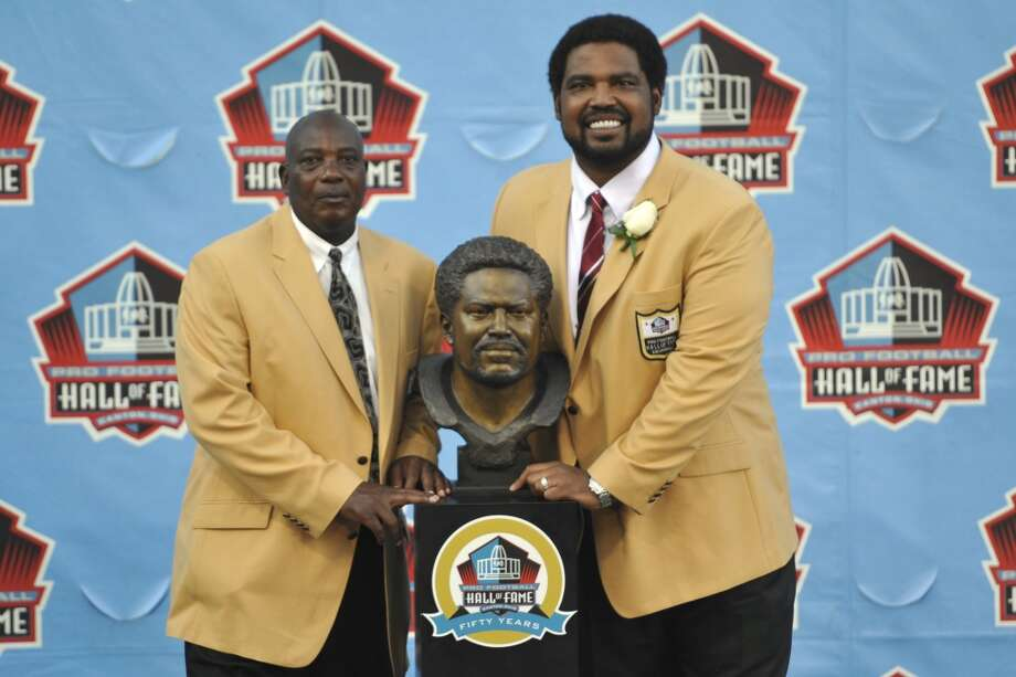 Inductee Jonathan Ogden, right, poses with his presenter, Baltimore Ravens general manager Ozzie Newsome, and a bust of himself during the induction ceremony at the Pro Football Hall of Fame Saturday, Aug. 3, 2013, in Canton, Ohio. (AP Photo/David Richard) Photo: David Richard, Associated Press