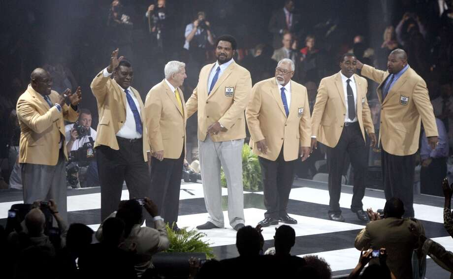 The Pro Football Hall of Fame Class of 2013 is introduced after receiving their symbolic gold jackets at the Enshrinees' Gold Jacket Dinner at the Canton Memorial Civic Center Friday, Aug. 2, 2013 in Canton, OH. From left are Warren Sapp, Dave Robinson, Bill Parcells, Jonathan Ogden, Curley Culp, Cris Carter and Larry Allen. The group will be enshrined into the Pro Football Hall of Fame Saturday.  (AP Photo/The Repository, Scott Heckel) Photo: Scott Heckel, Associated Press