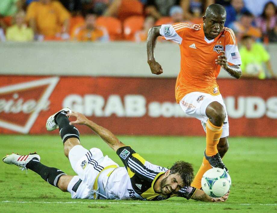 Dynamo midfielder Boniek Garcia (27) pushes past Columbus' Agustin Viana during the first half Saturday. Photo: Smiley N. Pool, MBO / Houston Chronicle