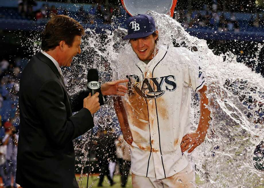 Rookie Wil Myers was cooled off by his teammates after delivering a walkoff win for the Rays on Saturday. Photo: Mike Carlson, FRE / FR155492 AP