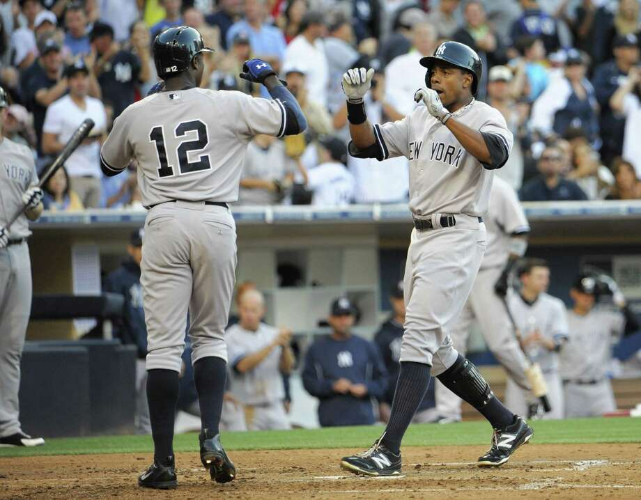 SAN DIEGO, CA - AUGUST 3:  Curtis Granderson #14 of the New York Yankees, right, is congratulated by Alfonso Soriano #12 of the New York Yankees after he hit a two-run homer during the seventh inning of a baseball game against the San Diego Padres at Petco Park on August 3, 2013 in San Diego, California.   (Photo by Denis Poroy/Getty Images) ORG XMIT: 163494834 Photo: Denis Poroy / 2013 Getty Images