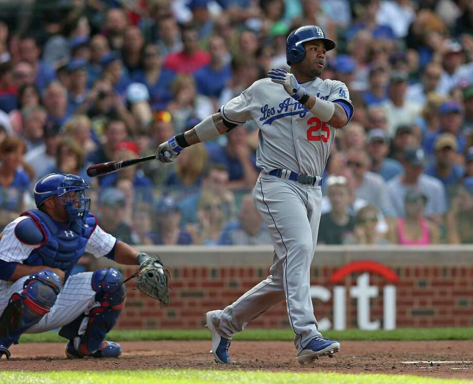 CHICAGO, IL - AUGUST 03:  Carl Crawford #25 of the Los Angeles Dodgers hits a two-run single in the 6th inning against the Chicago Cubs at Wrigley Field on August 3, 2013 in Chicago, Illinois. The Dodgers defeated the Cubs 3-0.  (Photo by Jonathan Daniel/Getty Images) ORG XMIT: 163494845 Photo: Jonathan Daniel / 2013 Getty Images