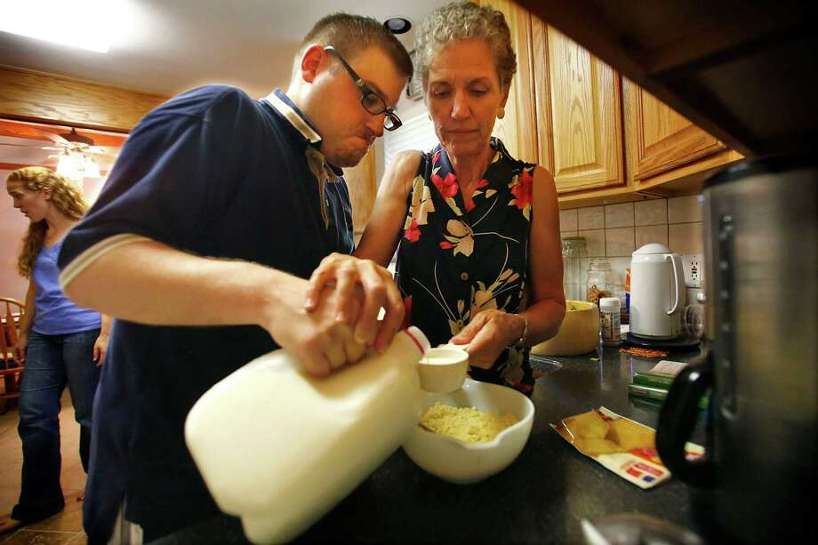 Linda Adamczyk helps her son, Max Adamczyk, make cornbread at their home in Far North Dallas, Texas, July 17, 2013. (Tom Fox/Dallas Morning News) Photo: Tom Fox / Dallas Morning News