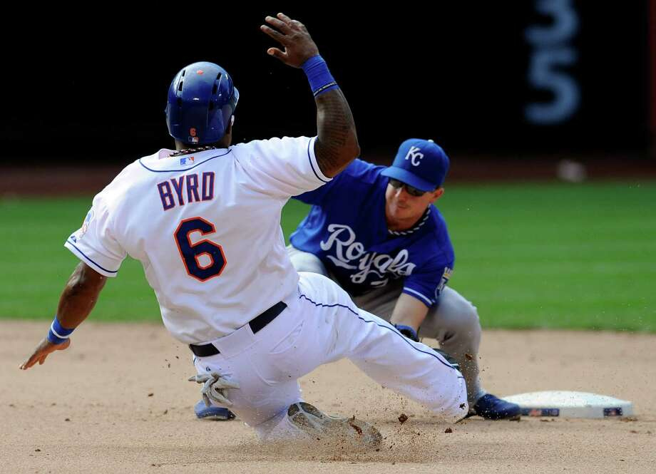 New York Mets' Marlon Byrd (6) is tagged out attempting to steal second by Kansas City Royals second baseman Elliot Johnson during the 11th inning of an interleague baseball game Saturday, Aug. 3, 2013 at Citi Field in New York. (AP Photo/Bill Kostroun) ORG XMIT: NYM111 Photo: Bill Kostroun / FR51951 AP