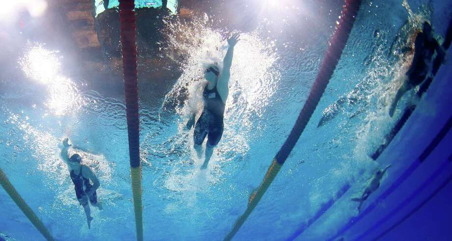 Katie Ledecky of the United States, centre,  swims to the gold medal in the Women's 800m freestyle final at the FINA Swimming World Championships in Barcelona, Spain, Saturday, Aug. 3, 2013. (AP Photo/David J. Phillip) ORG XMIT: WSC305 Photo: David J. Phillip / AP