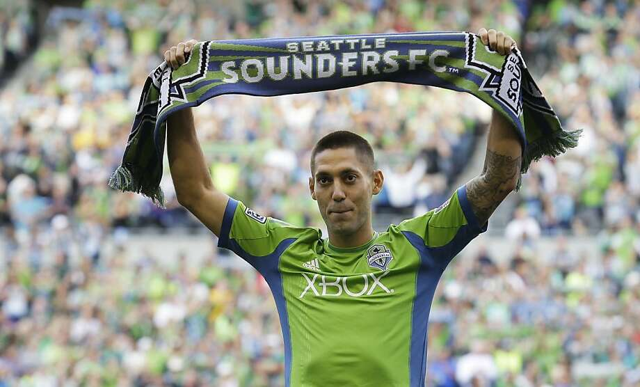 Clint Dempsey shows his true colors to Seattle Sounders fans before Saturday night's game. Photo: Ted S. Warren, Associated Press