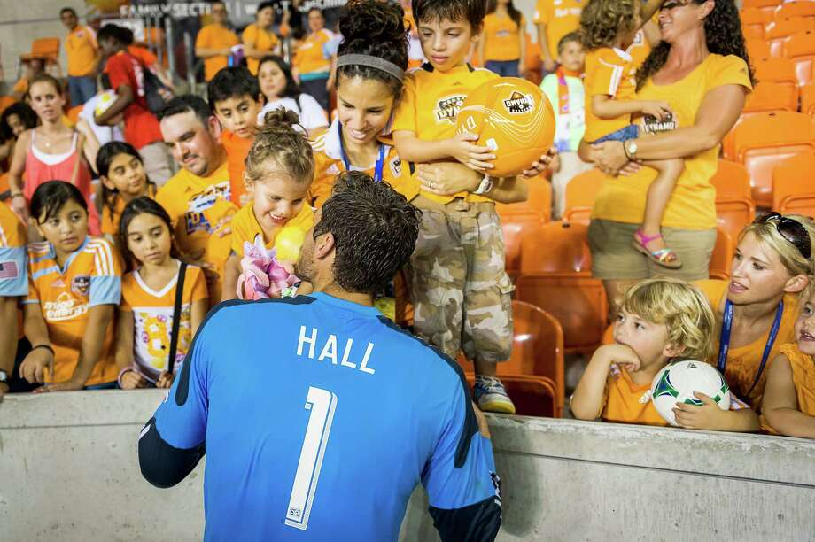 Houston Dynamo goalkeeper Tally Hall celebrates with his family after an MLS soccer match against the Columbus Crew on Saturday, Aug. 3, 2013, at BBVA Compass Stadium in Houston. The Dynamo won the game 3-1. Photo: Smiley N. Pool, Houston Chronicle / © 2013  Houston Chronicle